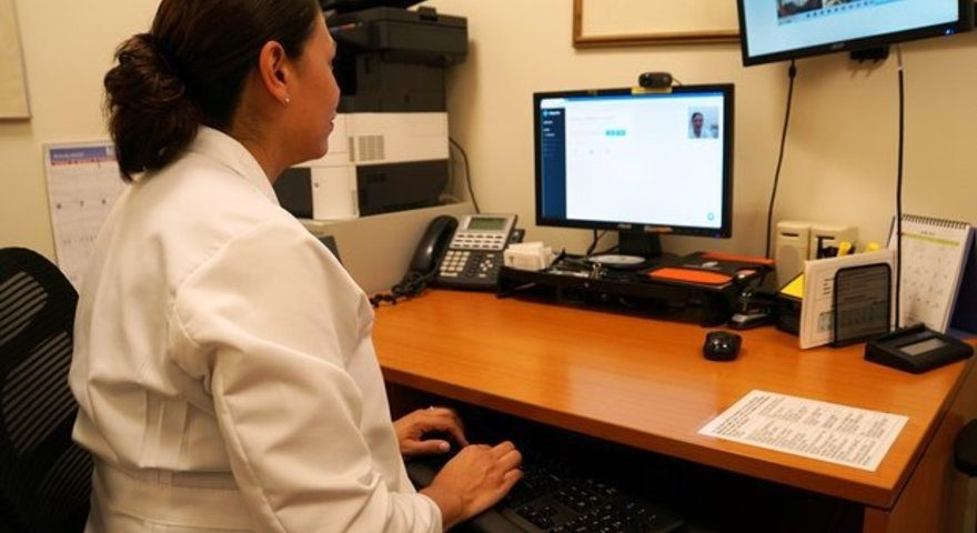 Esther Priegue, LCSW demonstrates the technology that will allow Choices Women's Medical Center to counsel patients who receive abortion drugs through the mail.