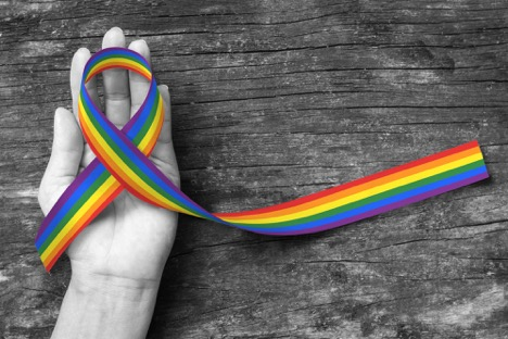 LGBTQ ribbon in hand