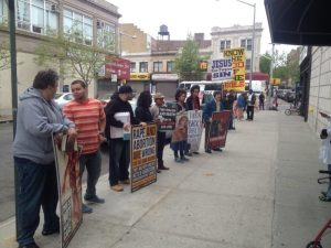 Anti-abortion protesters line the sidewalk outside Choices.