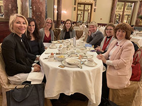 Merle Hoffman, Alena Popova and others from the Russia delegation having breakfast at the Metropol Hotel in Moscow.