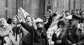 Merle Hoffman raises her trademark hanger outside St Patricks Cathedral in New York in 1989. This was historic first pro-choice civil disobedience action.